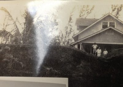 2740 Providence St. after 1926 hurricane; Australian pines in foreground.